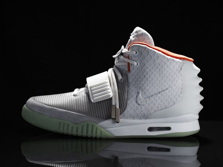 Kanye West's Nike Air Yeezy II sneakers were sold at a 400 per cent markup  as thousands finally got their chance to buy the footwear after waiting in  line ...