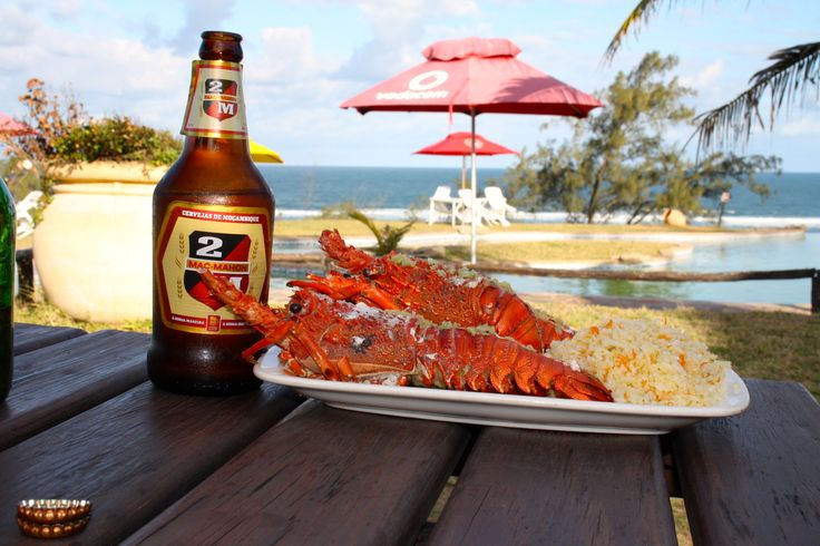 The epitome of Mozambique for me - the sea, sun, surf, crayfish and a 3M beer!