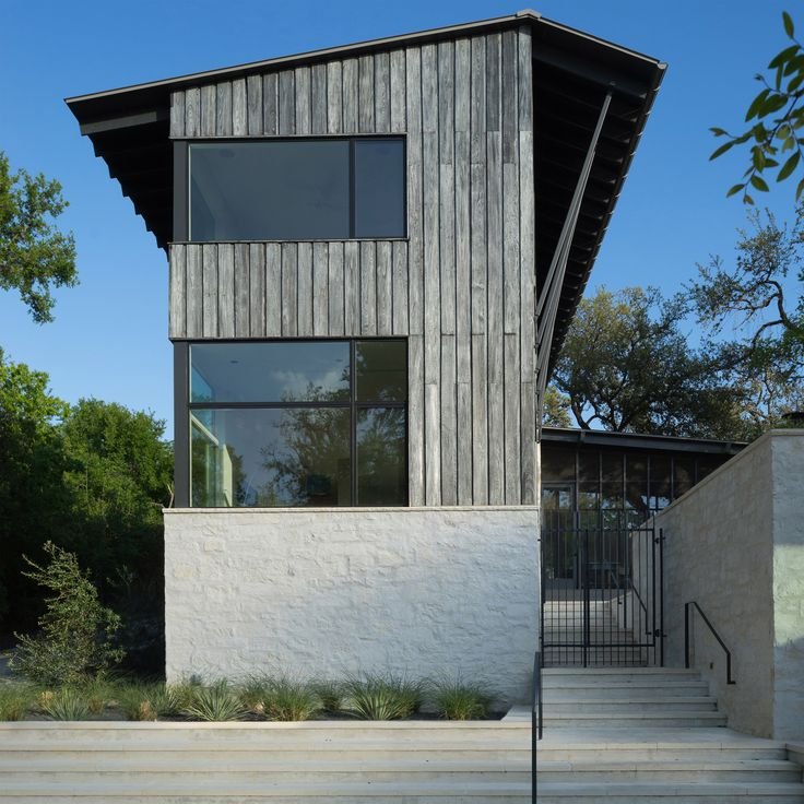 """Tim Cuppett Architects created a family dwelling with a """"camp-like aesthetic"""" that features a pool terrace and a large screened porch."""
