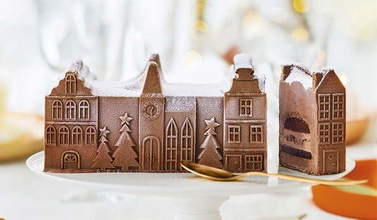 Bûche glacée chocolat (village) 8 parts Fondez pour sa crème glacée au chocolat noir, glace au chocolat au lait avec copeaux de chocolat noir, sauce au caramel et au chocolat, sorbet au cacao, meringue au cacao