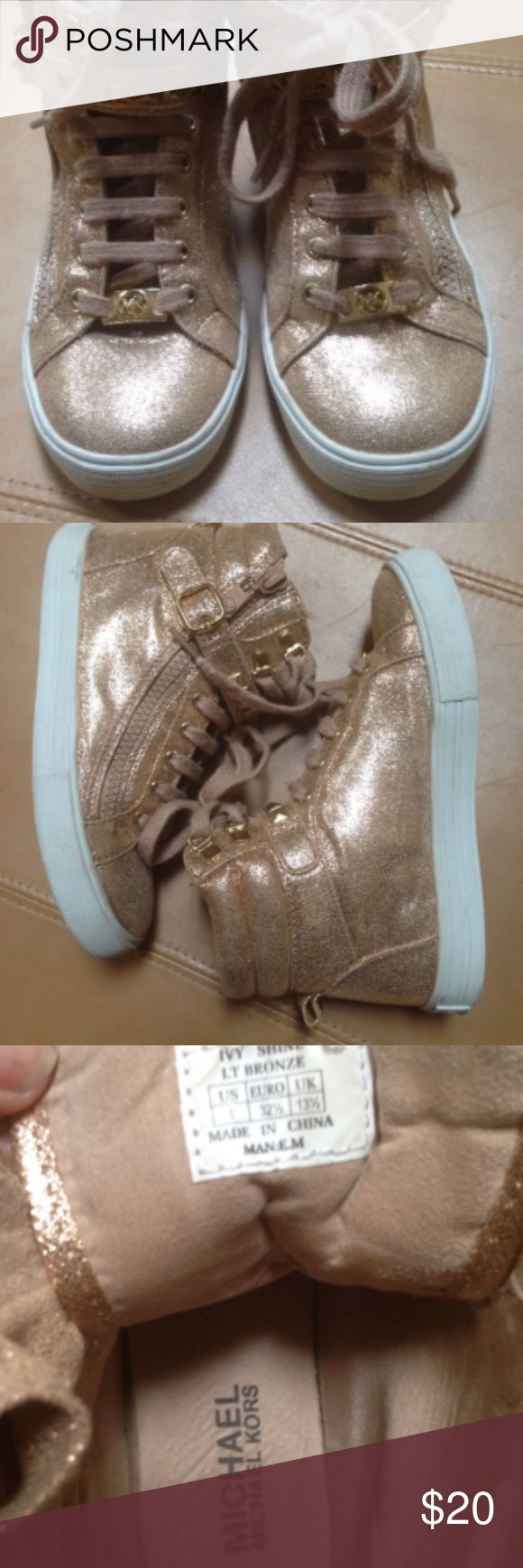 Ivy Shine Gold High Top Sneakers Great shape. Only worn a few times. Only sign of wear: slight paint wear on zipper pull edges, slight shoelace fuzzing and some wear on soles. Size 1. MICHAEL Michael Kors Shoes Sneakers