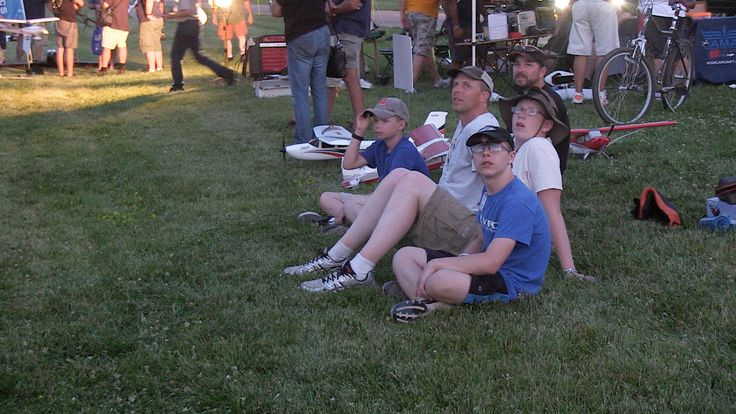 Spectators watch model aircraft and drones fly at Pioneer Airport during EAA AirVenture 2016. Jim Moore photo.