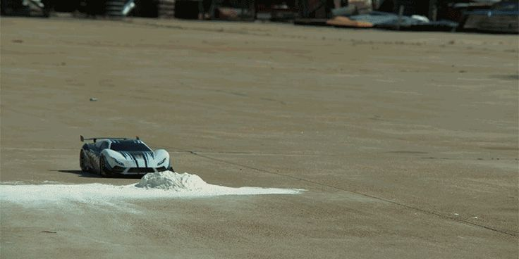 An RC Toy Looks Like a Hollywood Stunt Car in Super Slow Motion