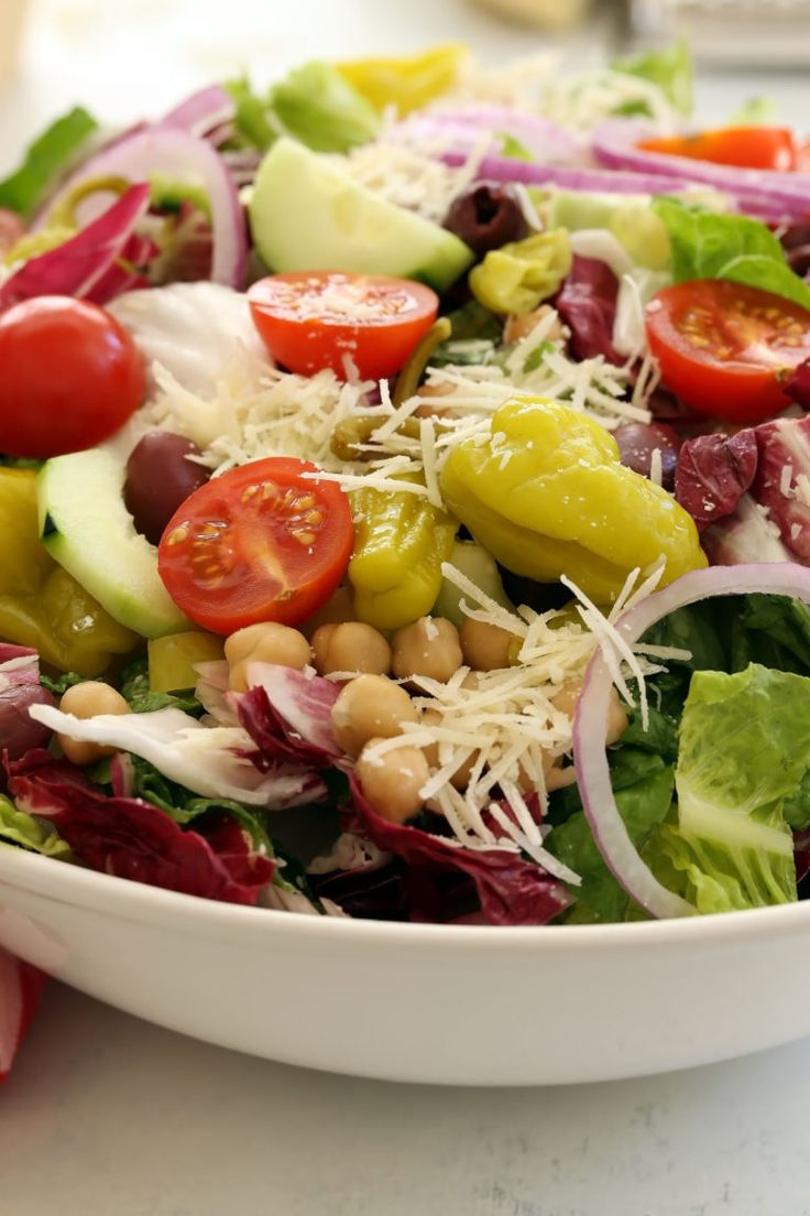 This Italian Chopped Salad is a quintessential chopped salad that's loaded with flavor and a delicious combo of ingredients. It's great to serve with any Italian dish, grilled chicken or salmon, yet filling enough to be a meal on its own. Perfect for warm summer nights, backyard barbecues and potlucks.