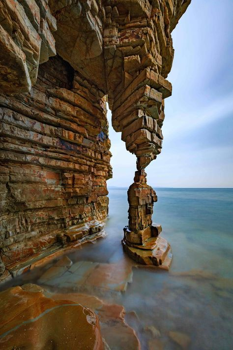 "DALIAN, TABLE LEG ROCK - 1548 - In a small secluded rocky beach, approximately 120 Km from Dalian, there is this beautiful rock formation called ""Table Leg Rock"". There is a small ""catch"" to go there: you have to walk along the beach beside a steep cliff at low tide to reach this place. When we went there it was around 3,30 p.m. Then you have to wait until the tide rises up to the feet of the rock to get a nice foreground of the stones covered by the sea, and this happened around 6 p.m. The…"