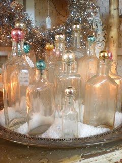 Candy colored vintage Christmas. like the idea of Christmas balls as bottle stoppers!
