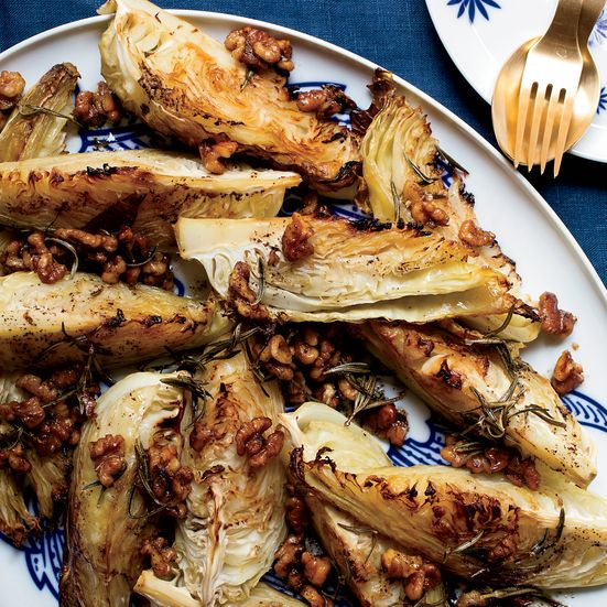 These hearty cabbage wedges, roasted until golden brown and topped with a fragrant, buttery dressing with rosemary and walnuts, can be made well in advance and served to a crowd.