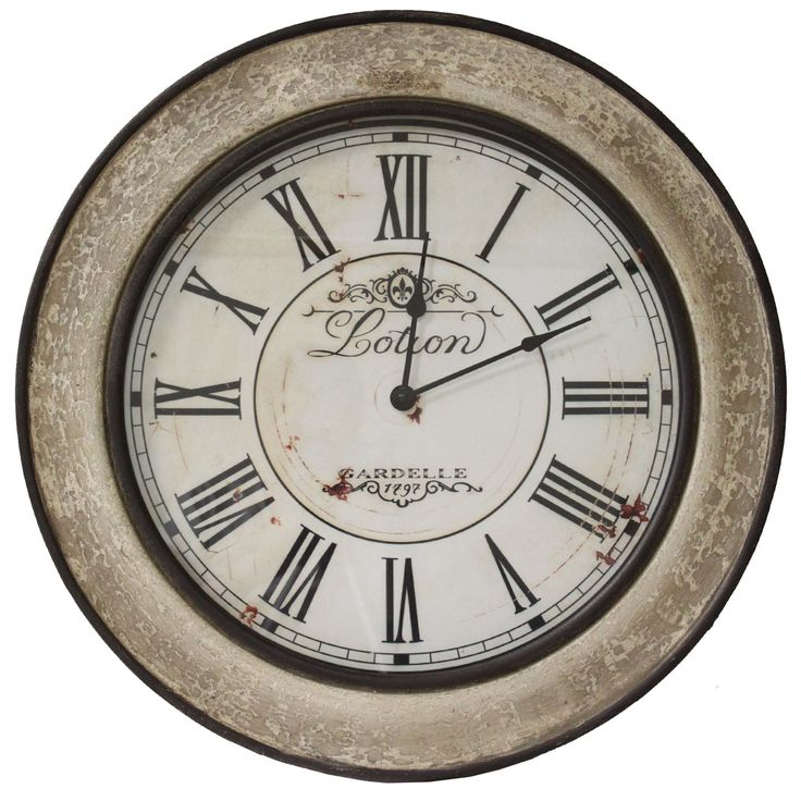 This stunning piece is inspired by classic English train station clocks. The design features a round distressed clock face with Roman numerals, cracked finish wood frame with black hour and minute hands.