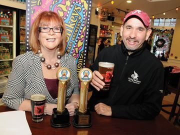 Province pours cash into Barrie brewery - MPP Ann Hoggarth raises a glass of good wishes with Flying Monkeys Craft Brewery president and chief brewmaster Peter Chiodo as she announces the Liberal government will support the brewery's expansion project.