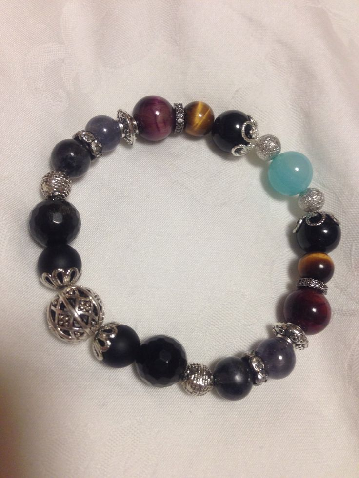Beads Bracelet ; Clint Barton in Avengers!   Black tourmalin, sea blue chalcedony, wine-colour tiger's eye, tiger's eye, onix, golden-sheen obsidian, iolite, black labradolite