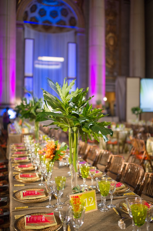 For the island-themed CTIA Wireless Foundation's Achievement Awards dinner, held in Washington in July, florist Volanni used banana leaves in tall, thin glass cylinders. Photo: Eli Turner