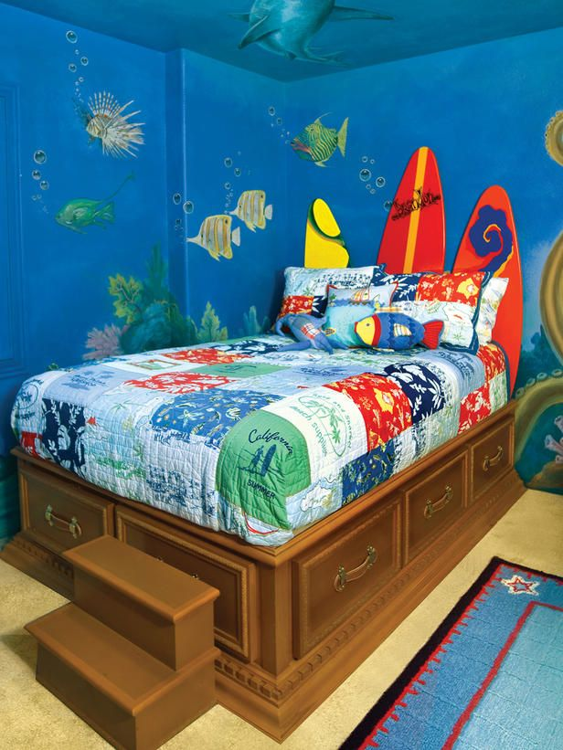 "Under the sea themed room  - Your little marine enthusiast will treasure this under the sea adventure room, complete with a gnarly surfing headboard and a treasure-chest bed. But the children's room mural is the star of the show in this water wonderland. ""When a child walks in the room and shuts his door, he feels, literally, like he's underwater"". ♥"