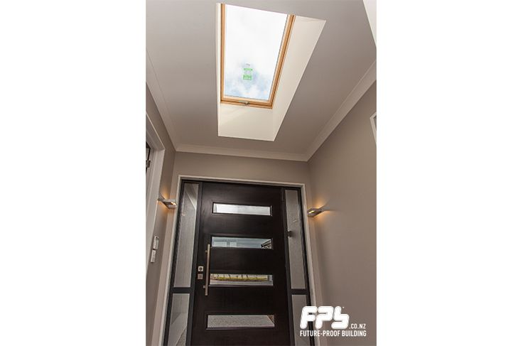 FAKRO skylight from HomeTech (www.hometech.co.nz) and opening roof window bring in natural light and fresh air.