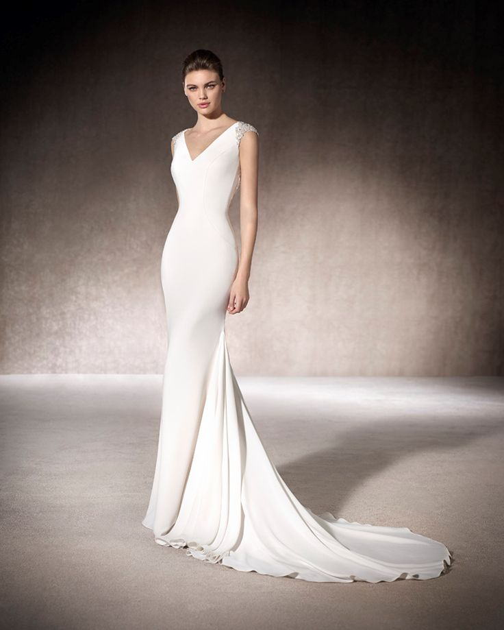 MILAN - Is the perfect minimalistic wedding dress for that 21st century, chic bride. Her gemstone embroidery on the back detail will leave a little DAZZLE.