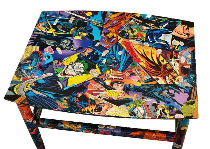 Batman Coffee Table. Sturdy coffee table decoupaged with authentic Batman comics. $240.00, via Etsy.