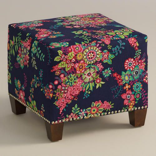"""Cozy up with our custom-made Moona McKenzie Ottoman, handcrafted in the U.S.A. with cotton upholstery and nail head trim. Showcasing a whimsical floral spray on a dark navy ground, this plush ottoman makes a bold statement. Pair two ottomans for a dramatic """"bench"""" at the foot of the bed. Shop our coordinating bed or headboard in the same custom fabric for a pulled together look."""