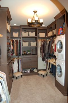 Love this idea!! one room as a closet/laundry room for the entire family.  You pick out your clothes in the a.m., take them to your bedroom to put them on, and when you're done with them put them in the laundry.  When everyone's clothes are clean, you just have to step across the closet room to put them away.