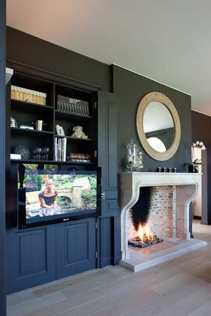 Fireplace with built in cabinet for tv to the side
