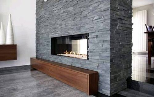 double sided fireplace in stone accent wall