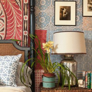 Peter Dunham - Coastal Living. Quilt or rug or whatever behind the headboard: a nice effect for creating a layered look.