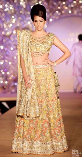 Yellow lengha. Abu Jani and Sandeep Khosla presents The Golden Peacock Collection.