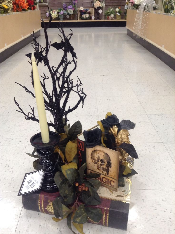 Halloween floral arrangement on book style boxes.                                                                                                                                                     More