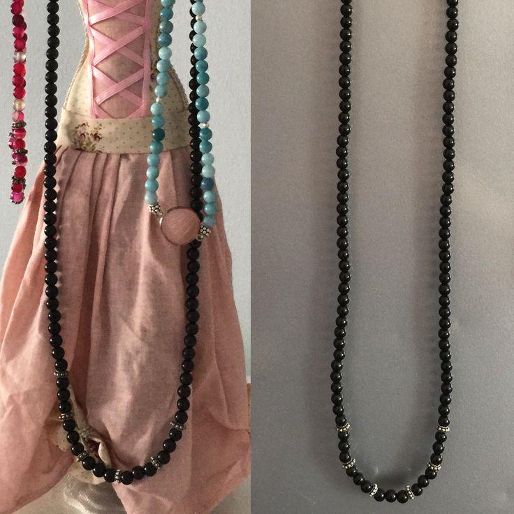 Oniks doğal taşından oluşan ve gümüş aparatlarla süslenmiş uzun kolye #gümüş #kolye #elyapımı #takı #doğaltaş #silver #jewelry #naturalstone