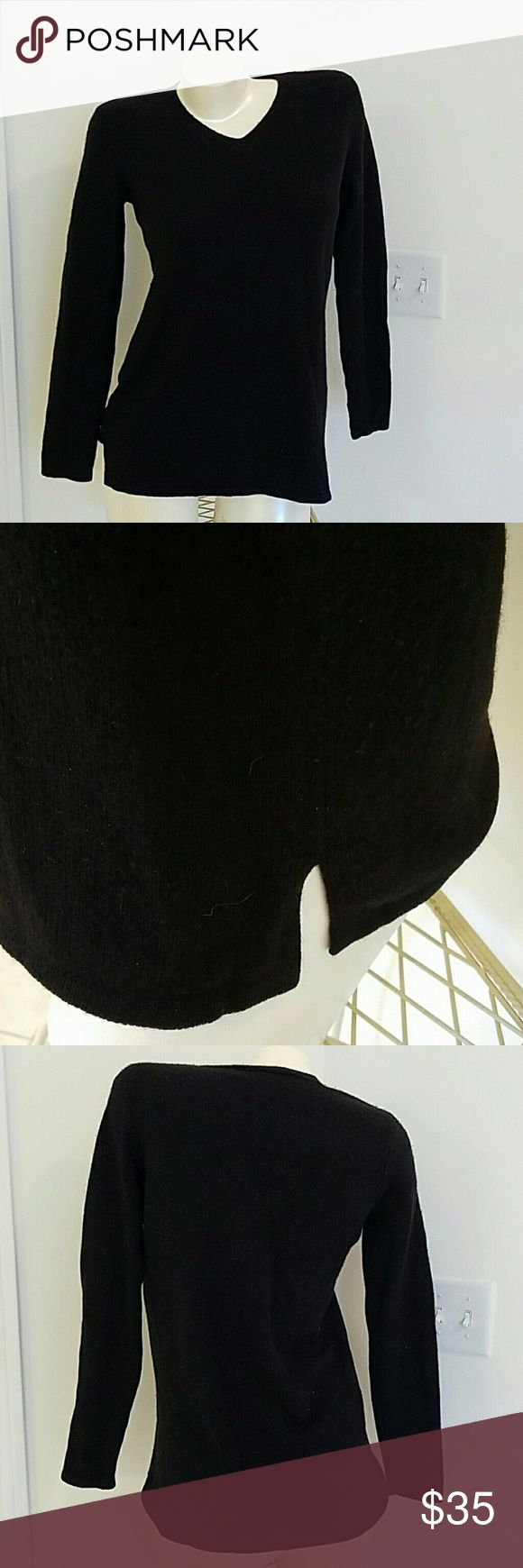 SAKS FIFTH AVE  Petites Black cashmere Saks Fifth Avenue Petites sweater good used condition no holes,smells ect. Soft and cozy.Winter is around, the corner. P  fits XS. Saks Fifth Avenue Sweaters Crew & Scoop Necks
