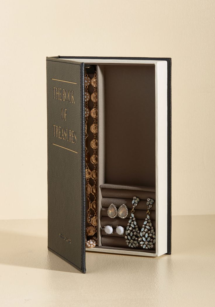 You know things are often not what they seem, and this jewelry box by Kikkerland fools even the cleverest of your visitors! Styled as an old-fashioned volume, this black case has a soft linen interior, strong magnetic clasp, and snaps for securing your necklaces - just in case you want to store this tricky tome upright on your bookshelf.