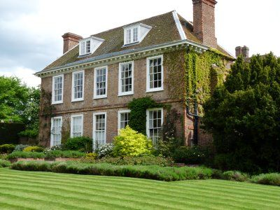 Love the hipped roof on this English manor house!
