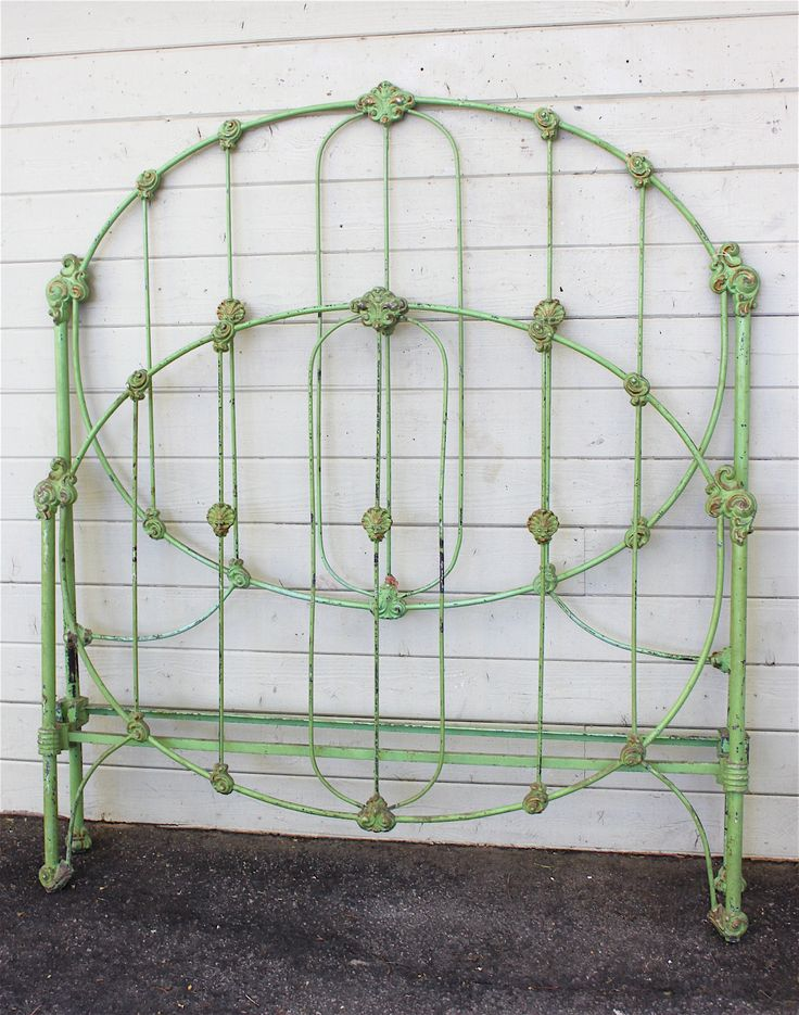 """This shade of """"green"""" was one of the most popular colors being used in the early 1800's. This """"wedding ring"""" style bed still has it's original paint job with subtle gold accented castings. #ironbeds #antiqueironbeds(another pinners words)"""