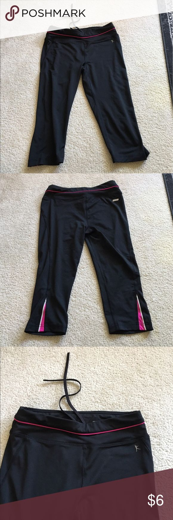 Danskin cropped leggings, S Cropped gym leggings by Danskin, size S. Features draw string inside the waist band and pink/silver reflective panels on the calf. Very good condition; comfortable, and flattering. Danskin Now Pants Ankle & Cropped