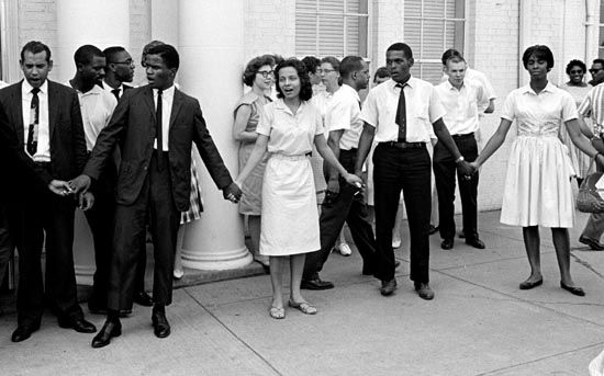 Diane Nash singing with demonstrators in front of a Nashville police station.br/Credit: The Nashville Tennessean