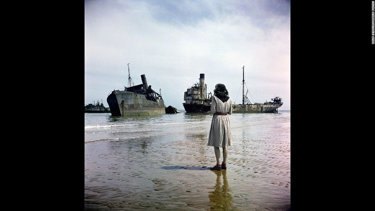 A woman walks on Omaha Beach in 1947, three years after the Allied forces invaded German-occupied France during World War II. The photo was taken by David Seymour, a famous Polish photographer also known as Chim. These color images, recently scanned and never seen before, follow the route the Allies took as they drove toward Berlin.