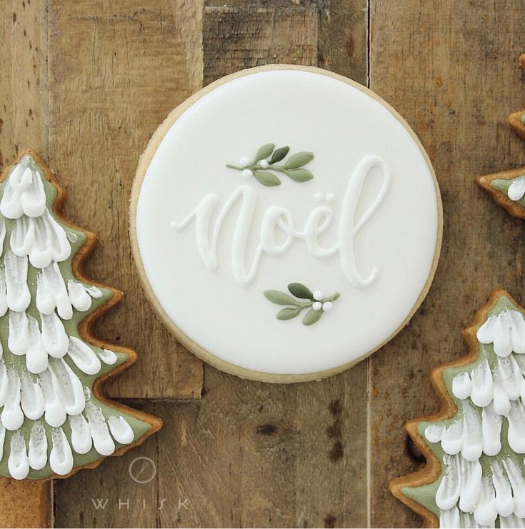 Noel hand decorated royal icing Christmas cookie, rolled cookies, cutout cookies, holly, Christmas trees