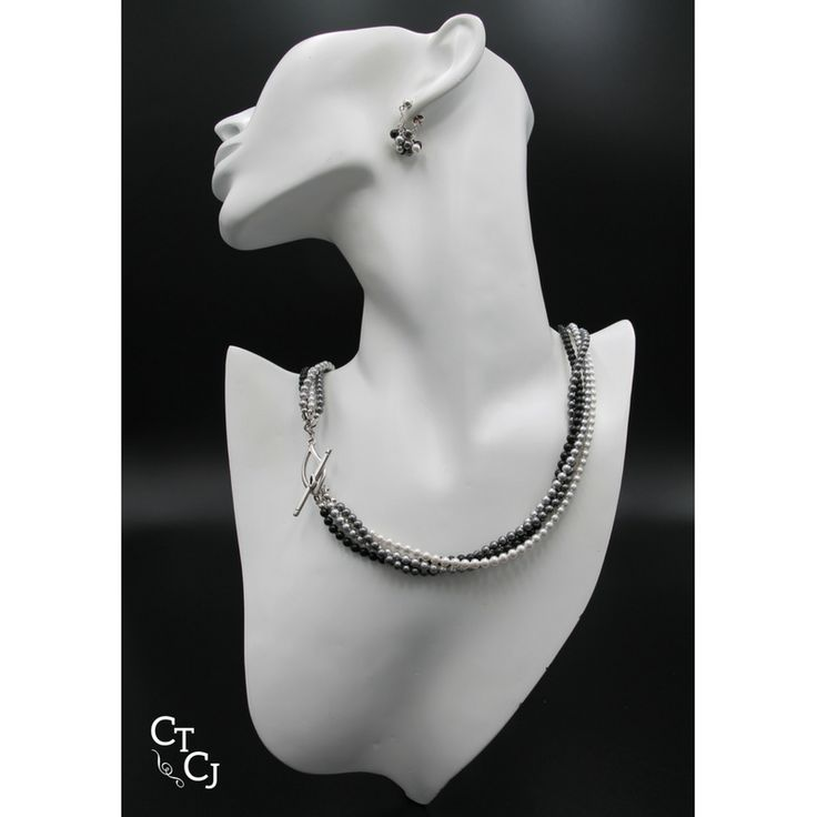 Swarovski black, grey, white pearls are awesome - wear them with jeans or something special.