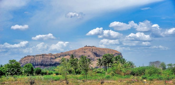 Dindigul Fort by srravi from http://500px.com/photo/217586975 - The Dindigul Fort or Dindigul Malai Kottai is a 17th-century hill fort built by Madurai Nayak situated in the town of Dindigul in the state of Tamil Nadu in India. The fort was built by the Madurai Nayak king Muthu Krishnappa Nayak in 1605. In the 18th century the fort passed on to Kingdom of Mysore (Mysore Wodeyars). During the reign of Hyder Ali and Tipu Sultan the fort was of strategic importance. In 1799 it went to the…