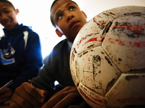 """Photo of the Day: May 17, 2012. """"School boys learning while dreaming of Soccer.""""  Tarah Waters (Denver, Colorado)  Photographed October 2010, Stellenbosch, South Africa"""