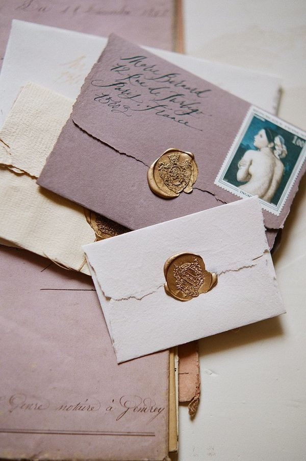 Hand Lettered Wedding Invitation Inspiration | These French-inspired wedding invitations are romantic and perfect for the vintage wedding. This bride used envelopes with tattered edges, antique stamps and a gold wax seal.