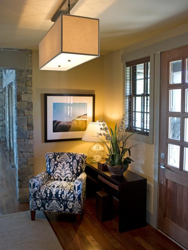 A cozy reading corner doubles as a design vignette. A club chair, upholstered in ikat, represents the first of the home's many references to the tie-dyed, woven fabric. 'It's a rustic, historic weave from tribal villages,' says interior designer Linda Woodrum. 'You have that contrast between the modern art and this historic print — I think that's important.'
