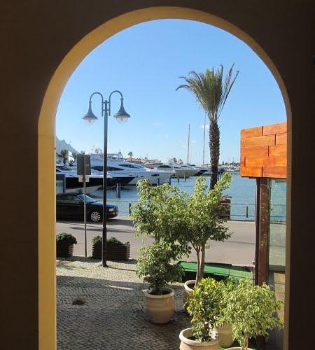 vilamoura marina view throu arches