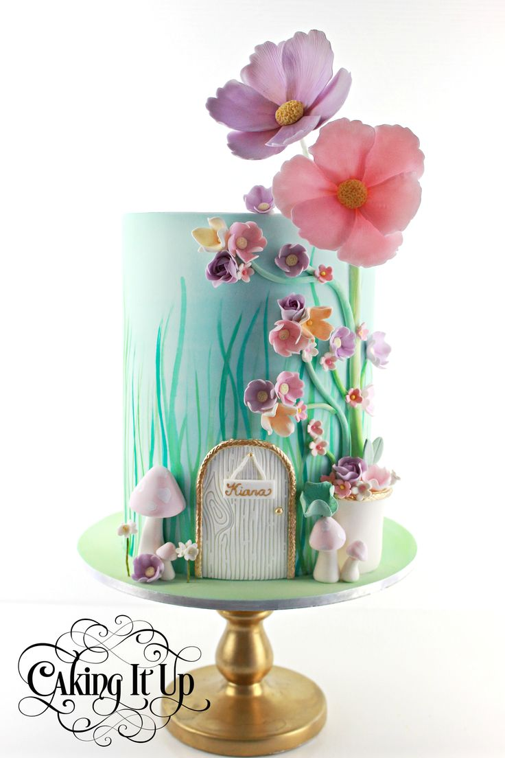 Double barrel one tier cake with handpainted grass and stunning sugar flowers. Pretty garden birthday cake.  www.facebook.com/cakingitup