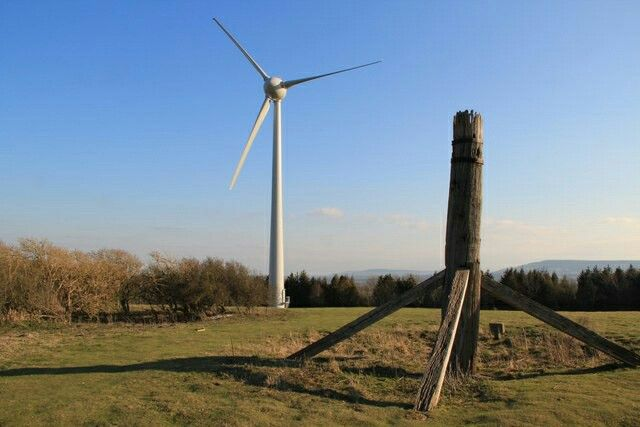 The main post of Ringmer post mill, near Lewes, which collapsed in 1926. Today it shares the site with a modern wind turbine.
