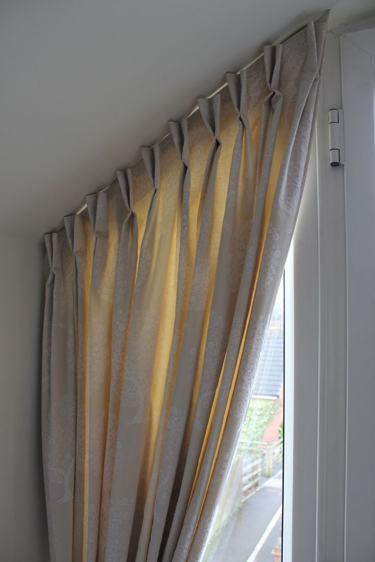 Bedroom curtains, a customers sloping window...double pinch pleat heading and Casadeco fabric. Designed by Just So Interiors