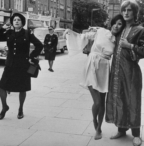 Traffic wardens crash an Ossie Clark fashion shoot, Fulham Road, London, 1967.