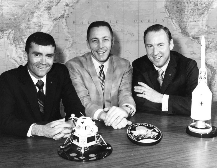 Fred Haise (left), Jack Swigert, and Jim Lovell pose on the day before launch. Swigert had just replaced Ken Mattingly as command module pilot after Mattingly was exposed to German measles.<br />