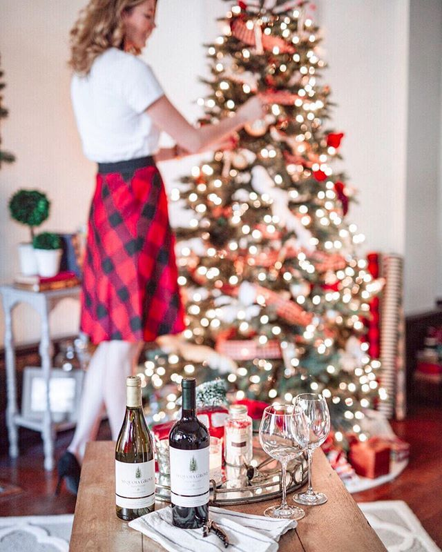 Decking the halls and prepping for guests to come over this week. The Holidays are always such a whirlwind it's easy to get overwhelmed so I'm sharing some tips on how to host guests for the Holidays in today's blog post (link in profile)! Hint it may involve keeping some @sequoiagrove wine on hand just in case . #darlingChristmastime #sequoiagrove photo by @dashacrawfordphoto  Get my outfit details with @liketoknow.it http://liketk.it/2tTFM #liketkitfollow along at…