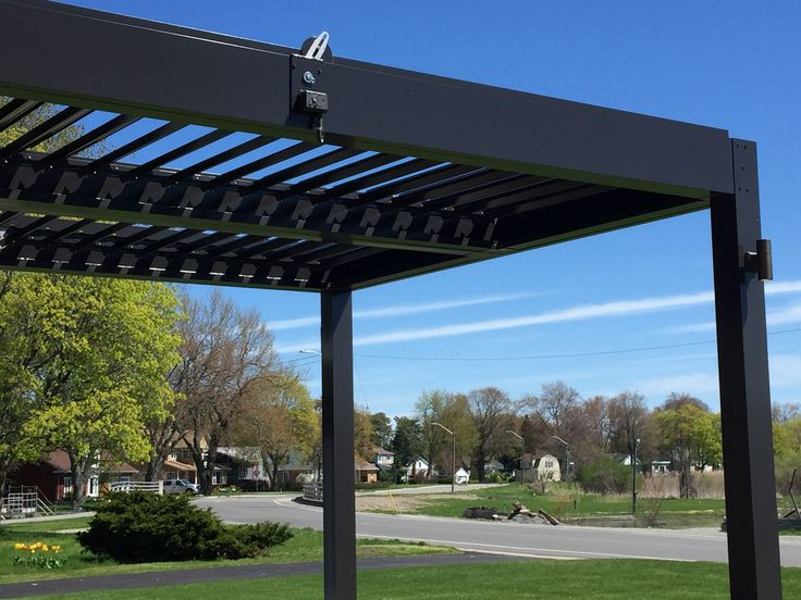 Aluminum Pergola louvers move at your command for full sun, filtered shade, or solid rain protection, allowing you to bring your living space outdoors.#aluminumpergola #pergola #pergolas #landscaping #landscapingarchitecture #landscapingideas #landscapingarchitects #backyard #backyards #backyardlandscaping