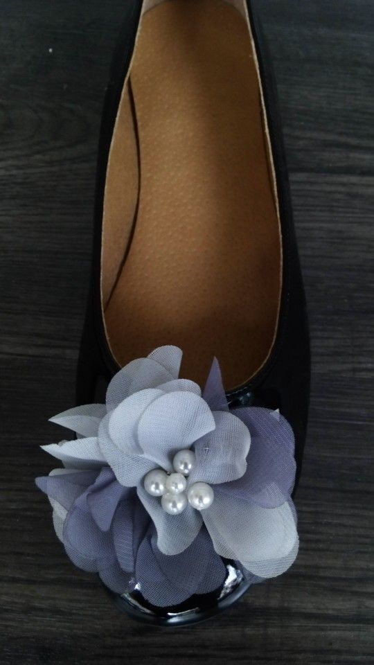 Handmade black leather ballerina decorated with a flower and pearls designed by Elli lyraraki