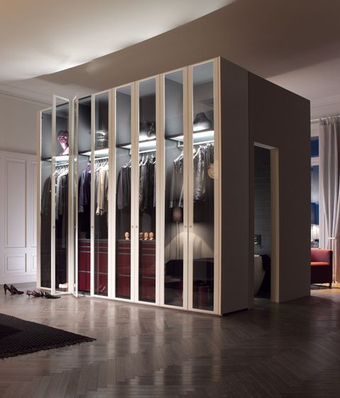 Free-standing closet with tall, glass doors and integrated LED lighting.
